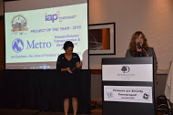 Dana Lucero of Oregon Metro (at podium) accepted the award with Gresham City Councillor Lori Stegmann