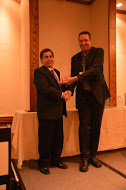 Dr. Don Haddad, Superintendent of St. Vrain Valley Public School District, received the award from USA judge Joel Mills